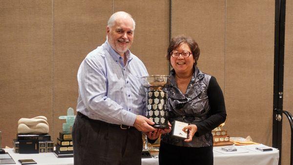 John Allman presenting Kay McGregor Trophy to Katie Mak