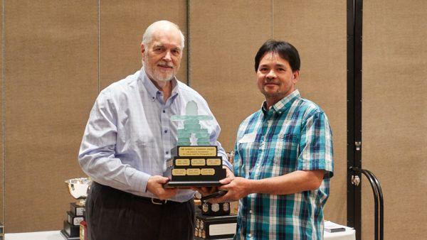 John Allman presenting Robert Zakrison Trophy to Roberto Veloso