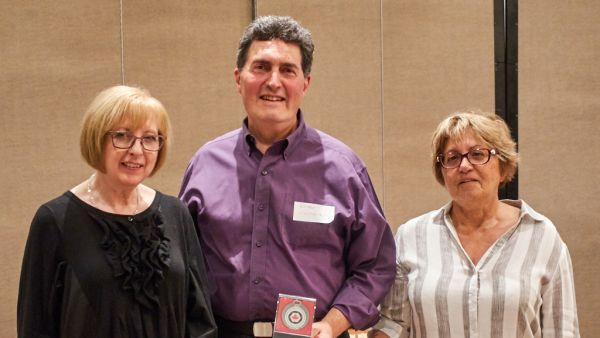Diana Noriel & Luba Citrin presenting Roger Correia with Silver Medal in Individual CAPA Competition (Altered Reality)